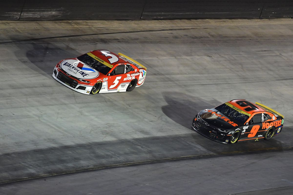 Chase Elliott, driver of the #9 Hooters Chevrolet, and Kyle Larson, driver of the #5 Valvoline Chevrolet, race during the NASCAR Cup Series Bass Pro Shops Night Race at Bristol Motor Speedway on September 18, 2021 in Bristol, Tennessee.