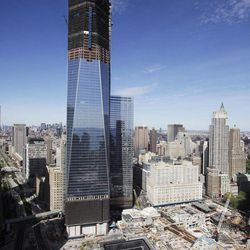FILE - In this April 17, 2012 file photo, One World Trade Center rises above the lower Manhattan skyline and the National September 11 Memorial and Museum, in New York. Eleven years after terrorists attacked the World Trade Center, the new World Trade Center now dominates the lower Manhattan skyline.