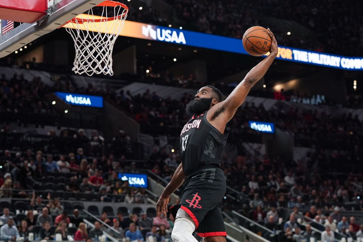 Houston Rockets guard James Harden goes up for a dunk in the second half against the San Antonio Spurs at the AT&T Center.
