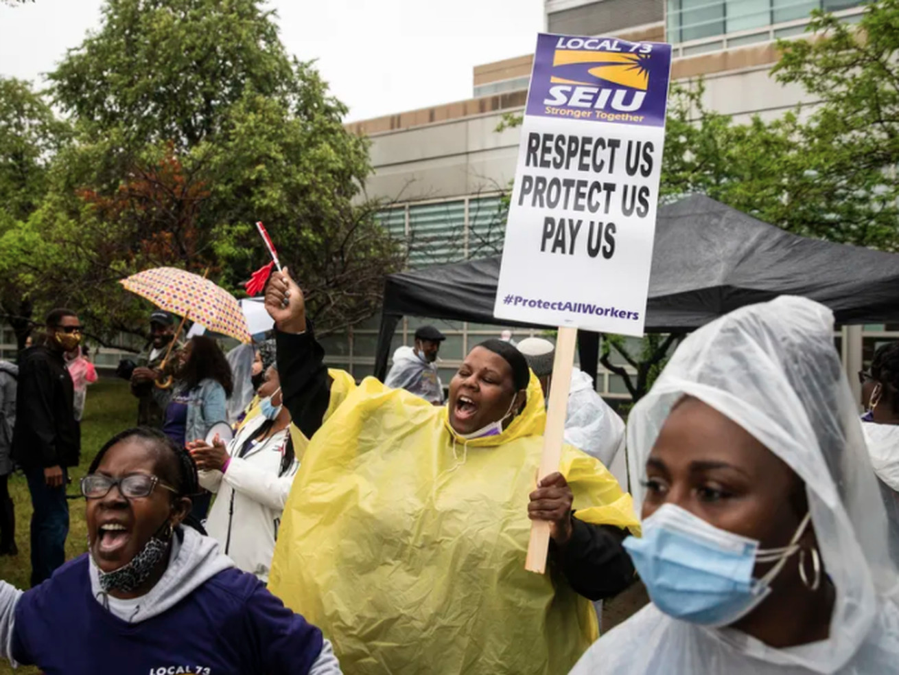 Striking SEIU Local 73 Cook County workers walk the picket line earlier this month outside Stroger Hospital on the Near West Side.