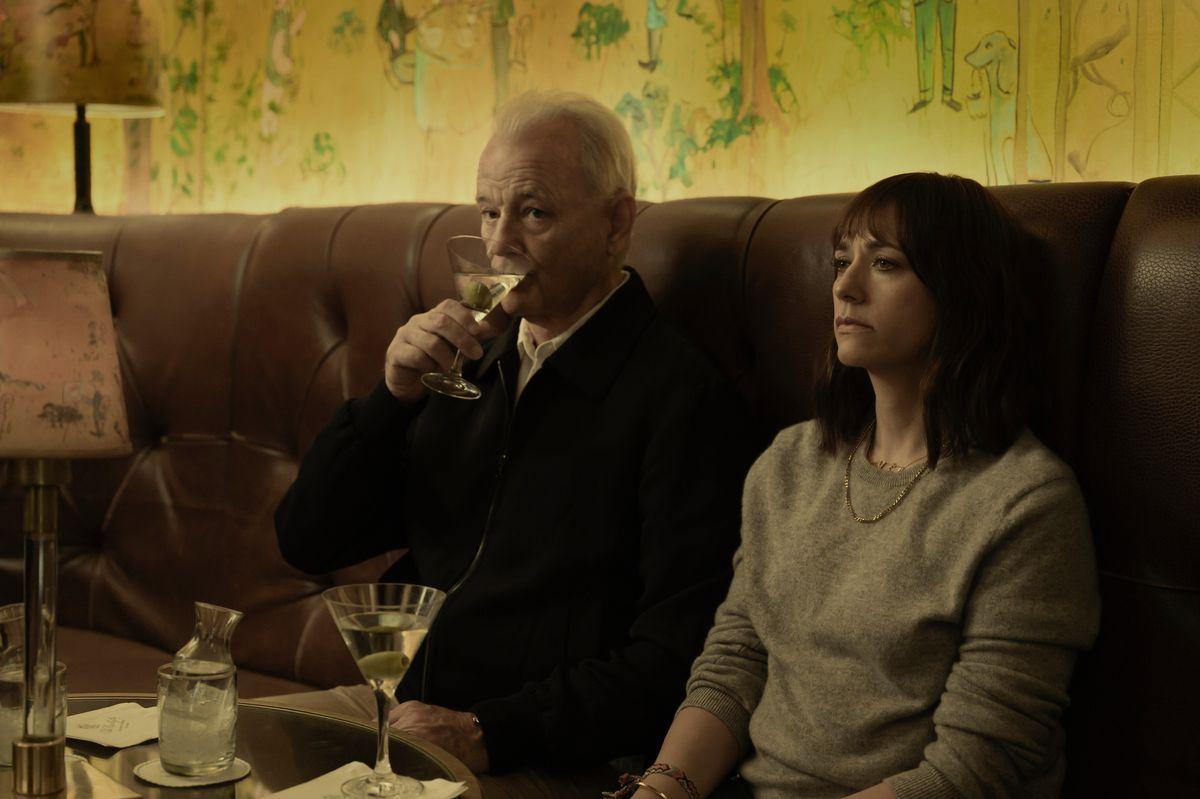 on the rocks: bill murray sips a martini while rashida jones lays on a table