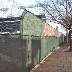 New decorative tarps partially installed along Waveland