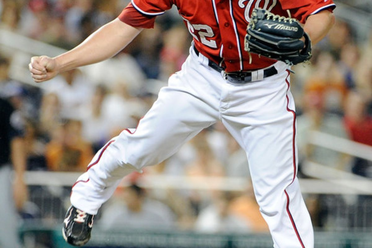 WASHINGTON, DC - JULY 30:  Drew Storen #22 of the Washington Nationals pitches against the New York Mets at Nationals Park on July 30, 2011 in Washington, DC. The Nationals won the game 3-0. (Photo by Greg Fiume/Getty Images)