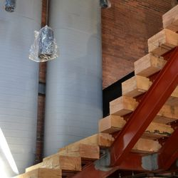 White pine stairs at the entrance to the restaurant lead to the second floor dining area.