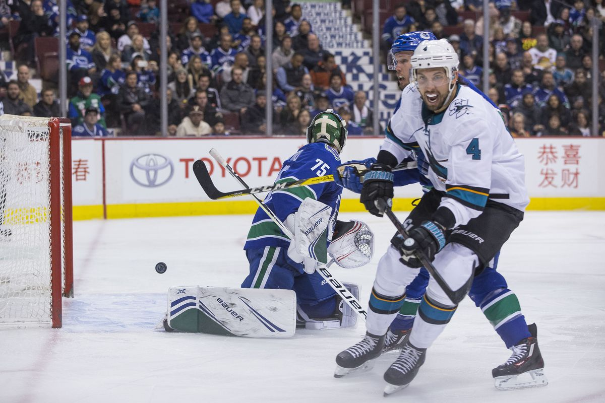 Feb 11, 2019; Vancouver, British Columbia, CAN; San Jose Sharks defenseman Brenden Dillon (4) celebrates a goal scored by forward Evander Kane (9) on Vancouver Canucks goalie Michael Dipietro (75) in the second period during a game at Rogers Arena.