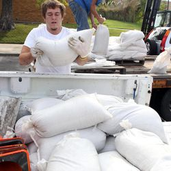 Nick Murphy, left, and Chris Kerns load sand bags into the back of a pick-up truck Thursday, Aug. 30, 2012, at Hill Wheatley Plaza in downtown Hot Springs, Ark. The city of Hot Springs was providing the sand bags to downtown area property owners, an area with a history of flooding, in preparation for the remnants of Isaac. Forecasters say the storm will track right through Arkansas.