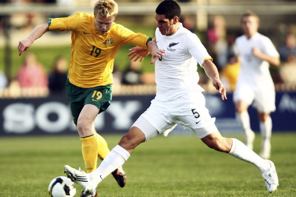 Michael Boxall, right, of New Zealand tries his luck against Australian Matthew Simon in a 2008 U-23 international. (Brendon Thorne/Getty Images)