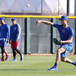 Yu Darvish throws a baseball while Duane Underwood Jr. and Jen-Ho Tseng walk in the background on field 1 at Riverview Park, the Spring Training home of the Chicago Cubs, in Mesa, AZ.   John Antonoff/For the Sun-Times