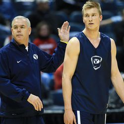 BYU's Head Coach Dave Rose, smacks Eric Mika on the back during  practice Wednesday, March 19, 2014 in the Bradley Center as they prepare to play Oregon in the second round of the NCAA tournament in Milwaukee on Thursday.