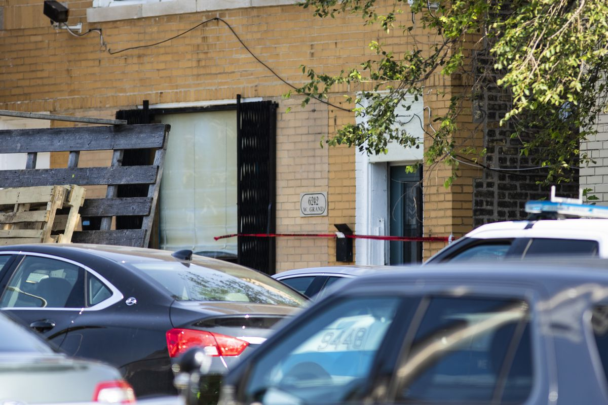 Crime scene tape outside a building in the 6200 block of West Grand Avenue after a Chicago police officer shot an alleged suspect on July 8, 2019.