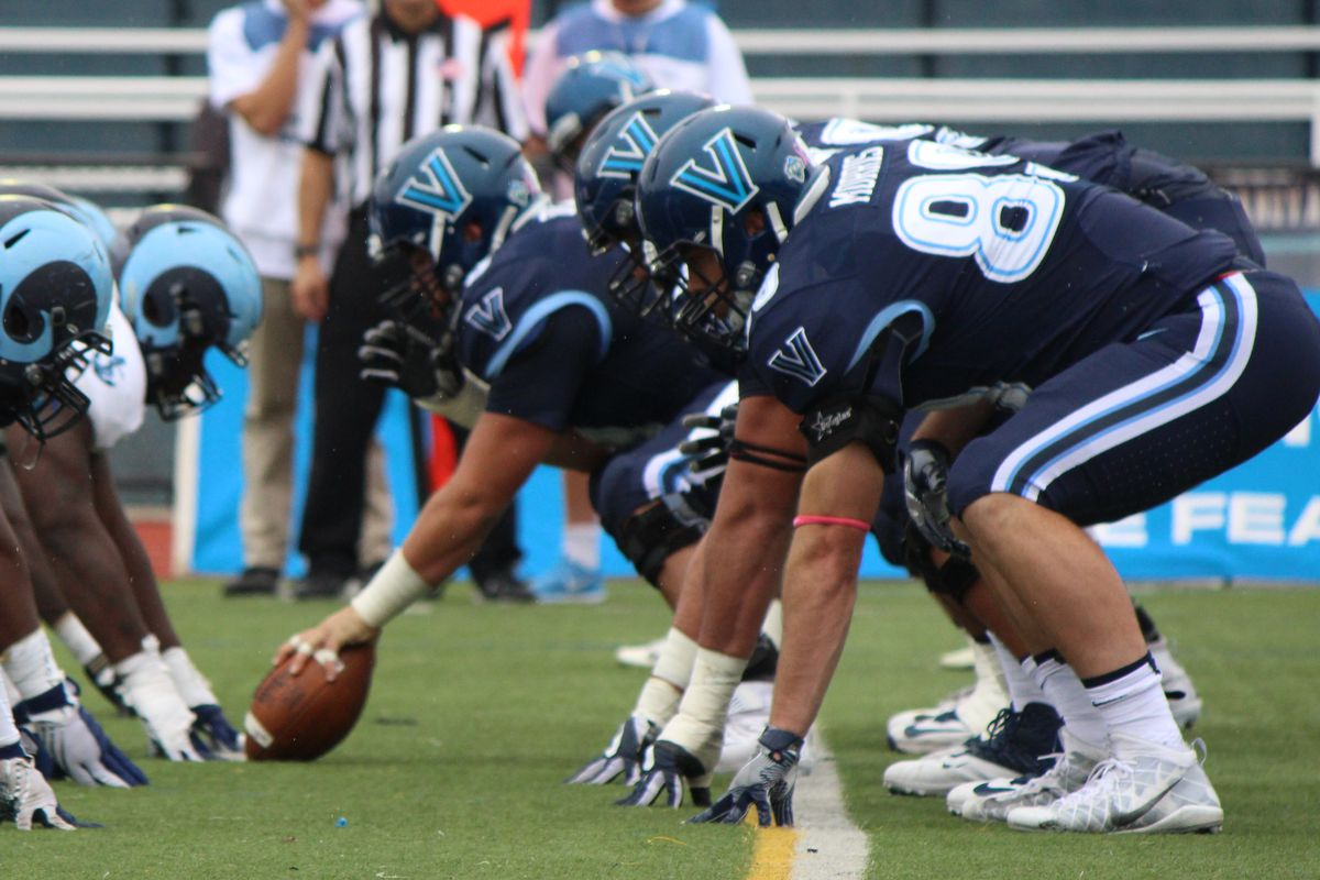 The Villanova offensive line takes their stance against the Rhode Island Rams.