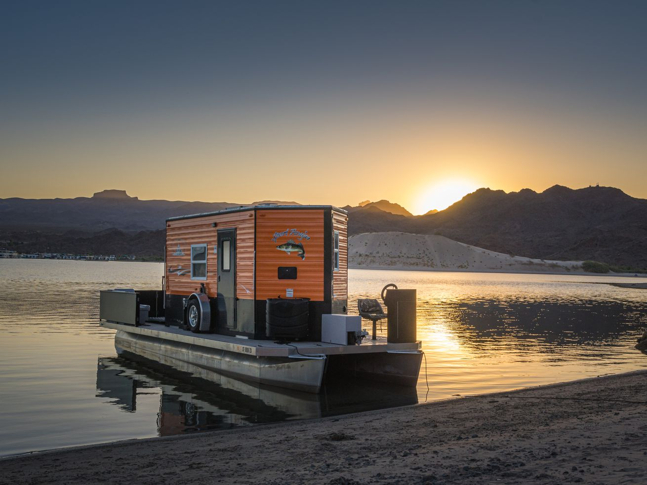 With this tiny home-inspired houseboat, you can camp by land or sea