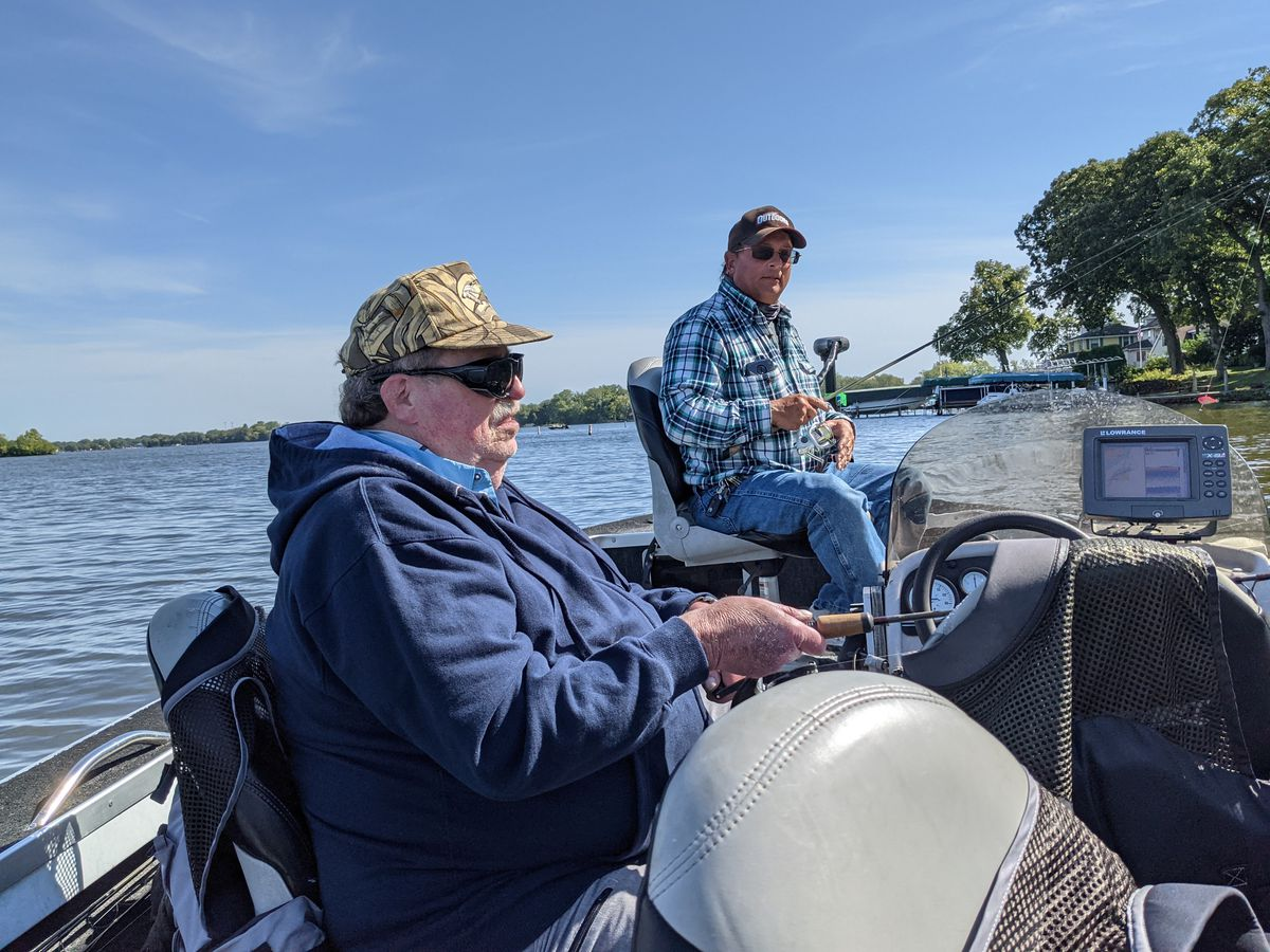 Mike Jackson and guide Phil Piscitello fishing on the Chain O'Lakes last week. Credit: Dale Bowman