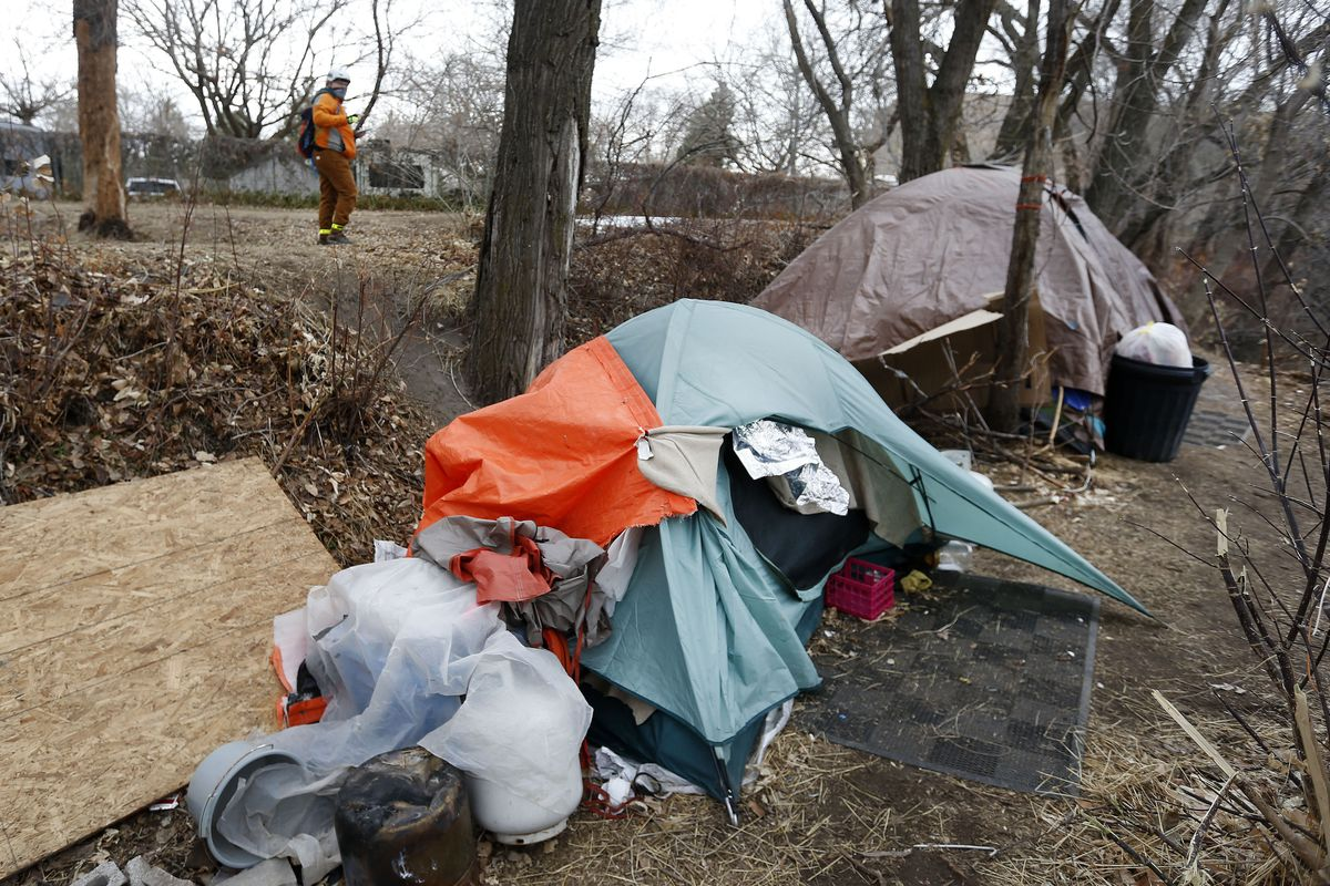 Soren Simonsen, executive director of the Jordan River Commission, takes down information as to where he is seeing homeless camps during the 2021 Point-in-Time count, a nationwide annual event to survey people experiencing unsheltered homelessness, in Salt Lake City on Thursday, Jan. 28, 2021.