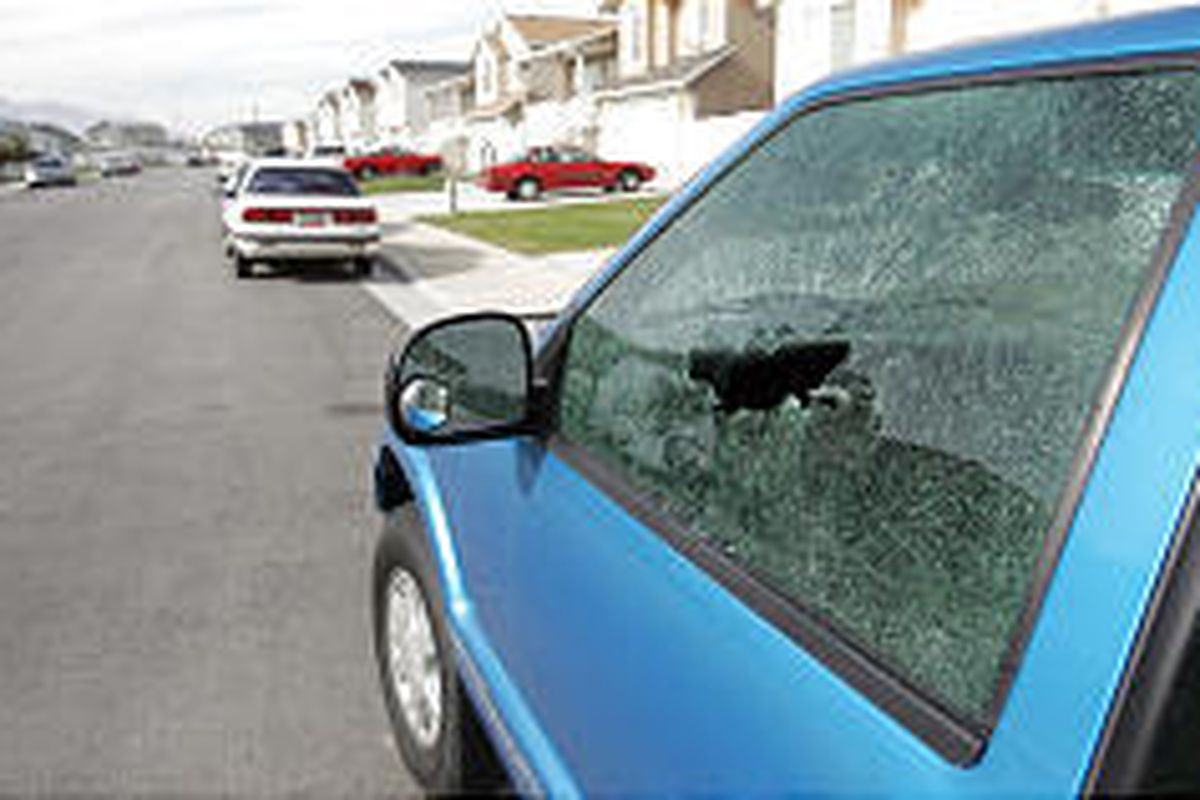 Police in West Valley City were looking Wednesday for the vandals who smashed between 50 and 60 car windows in an overnight spree.