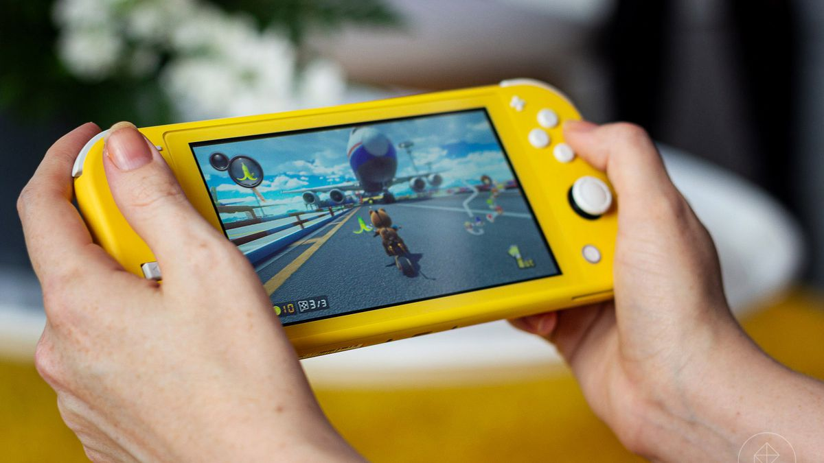 Photograph of a yellow Nintendo Switch Lite playing Mario Kart 8 Deluxe