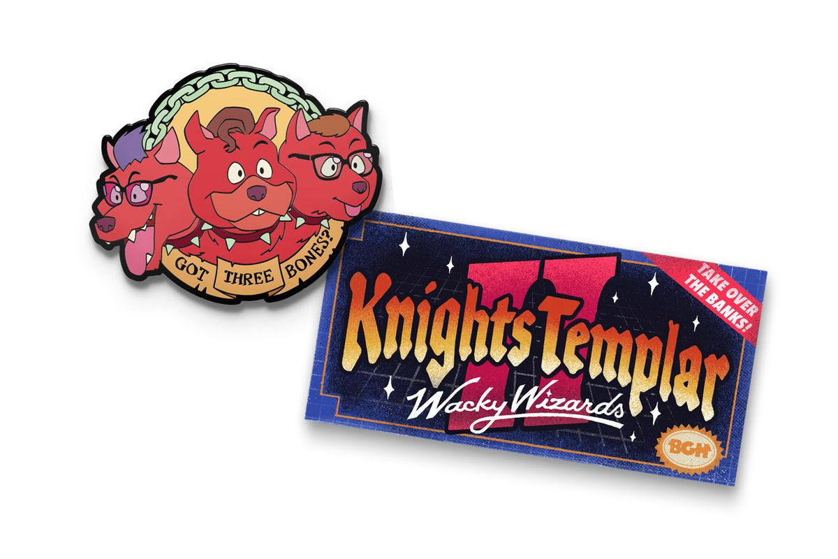 """Image of the two January McElroy merch items. At the top is an enamel pin of the brothers as a red cerberus with a green chain at the top and a banner beneath that says, """"Got three bones?"""" Below is a decal in tones of blue and purple that says, """"Knights Templar II: Wacky Wizards."""""""