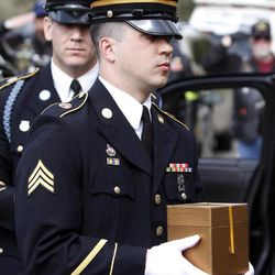 A soldier carries the urn holding the remains of Civil War veteran Peter Knapp during his military funeral at Willamette National Cemetery in Portland, Ore., Friday, April 13, 2012.  Peter Knapp is the first Civil War veteran buried at Willamette National Cemetery, Oregon's largest veterans' cemetery. His ashes had been sitting on a shelf at the Portland Crematorium since 1924.