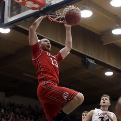 Utah forward David Collette (13) dunks in front of Saint Mary's center Jock Landale (34) during the first half of an NCAA college basketball game in the quarterfinals of the NIT, Wednesday, March 21, 2018, in Moraga, Calif. (AP Photo/Marcio Jose Sanchez)