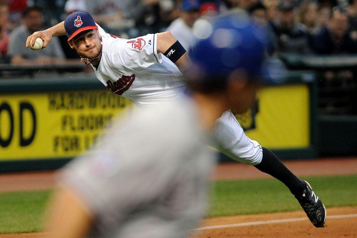 May 4, 2012; Cleveland, OH, USA: Cleveland Indians third baseman Jack Hannahan (9) throws out Texas Rangers second baseman Ian Kinsler (5) at Progressive Field.  Mandatory Credit: Eric P. Mull-USPRESSWIRE