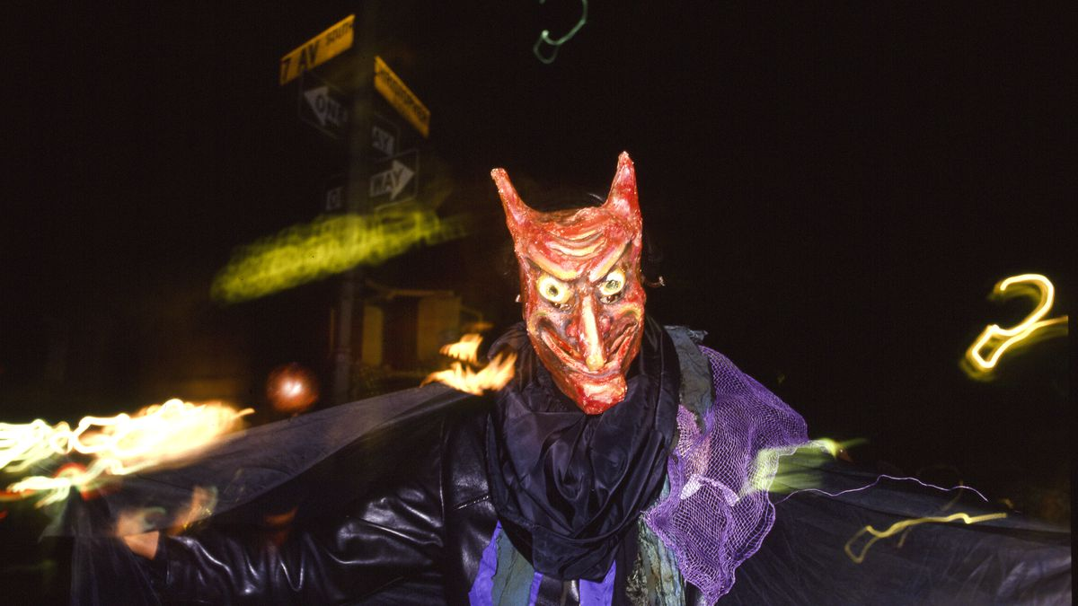A participant dressed in a devil costume during an annual Halloween parade in New York.