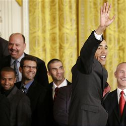President Barack Obama waves as he welcomes the Major League Soccer champions Real Salt Lake at the White House Friday.