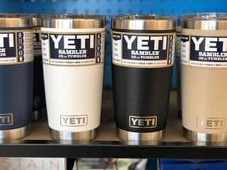 A row of mugs on a store shelf.