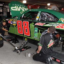 ADDS DATELINE - Dale Earnhardt Jr.'s team does some last-minute work on his car in the garage at the Martinsville Speedway, before NASCAR's Goody's Fast Relief 500 auto race, Sunday, April 1, 2012, in Martinsville, Va.
