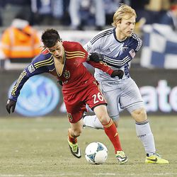Real's Sebastian Velasquez is held by Kansas City's Seth Sinovic as he tries to push the ball as Real Salt Lake and Sporting KC play Saturday, Dec. 7, 2013 in MLS Cup action. Sporting KC won in a shootout.
