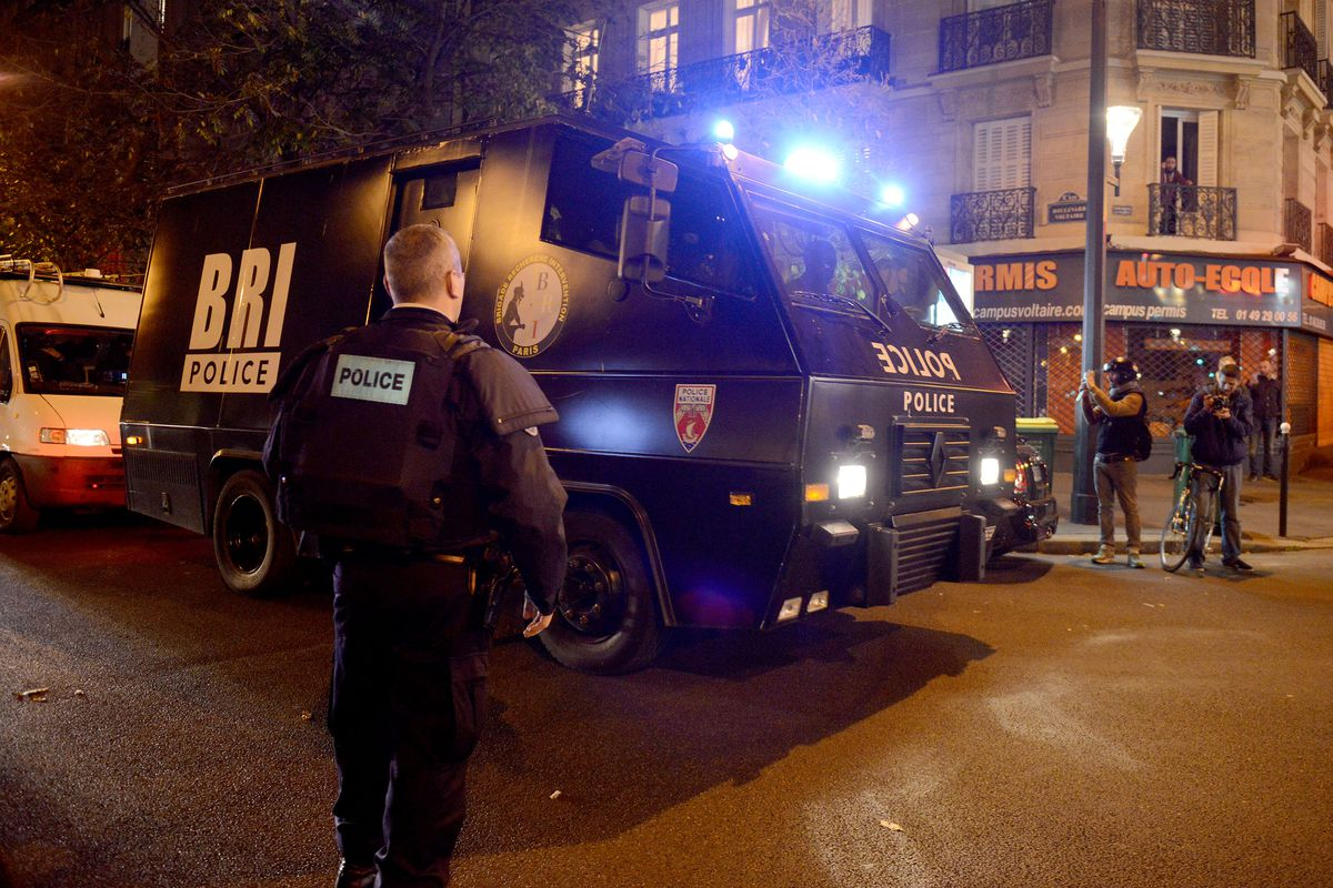 Policeman patrol near the Bataclan after the attacks Friday.