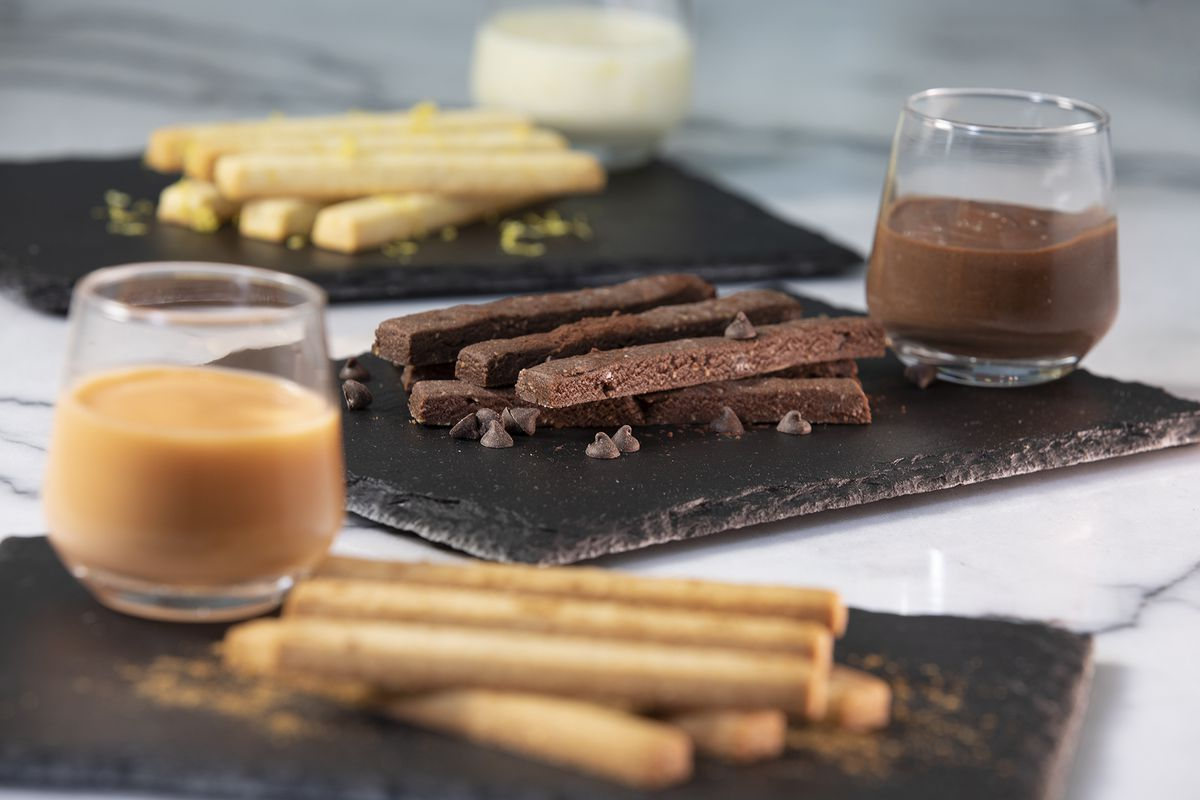 A plate of cookies in a stick shape