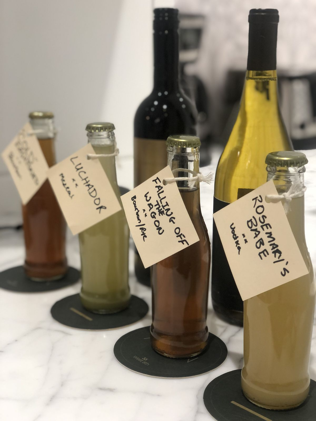 Four individually bottled cocktails for delivery
