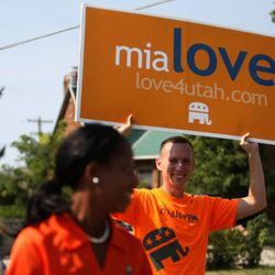 Jason Love walks with his wife Mia Love in the Harvest Days Parade in Midvale on Saturday, Aug. 11, 2012.