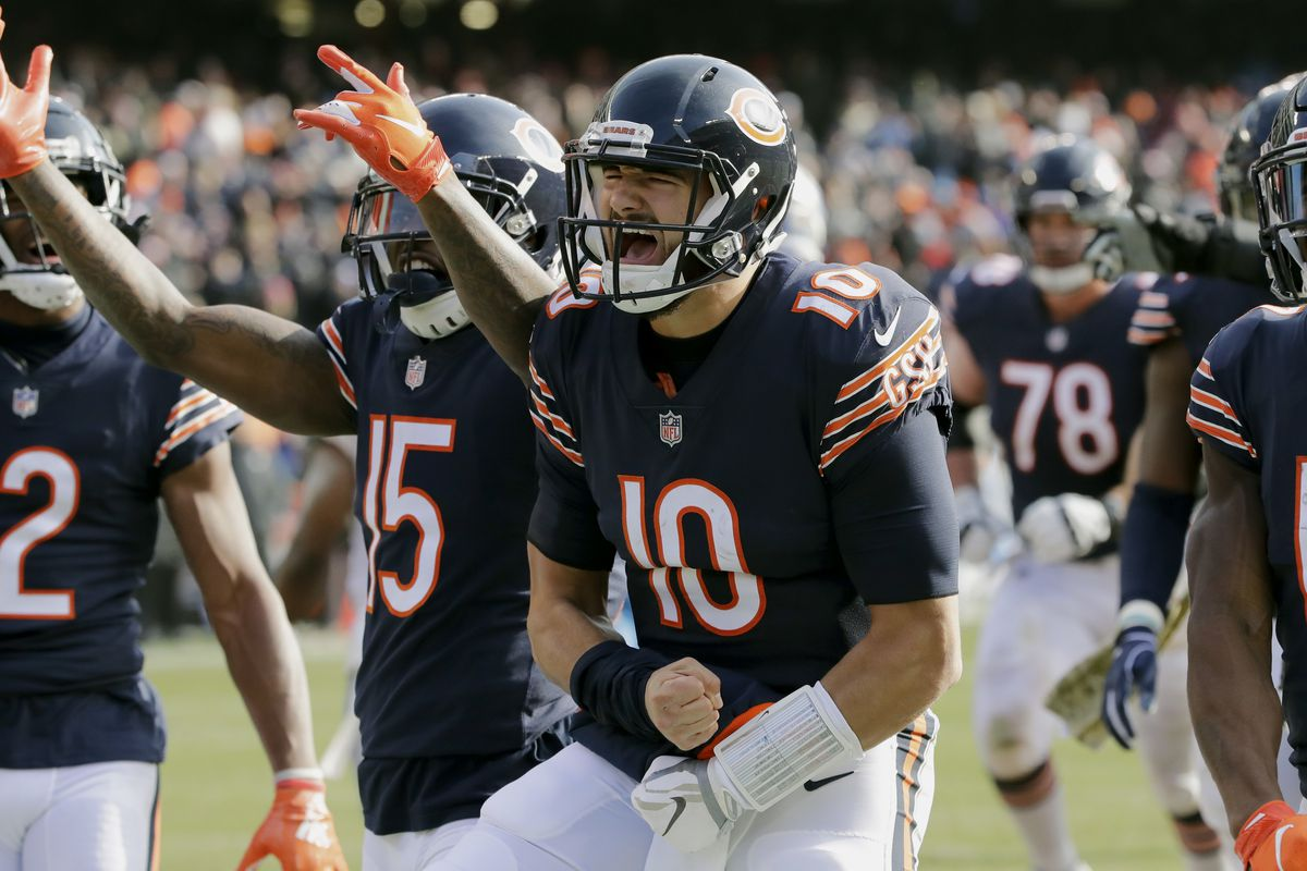 """Bears quarterback Mitch Trubisky (10, celebrating a touchdown run against the Lions in 2018) will battle Nick Foles in an """"open competition"""" for the starting job whenever the 2020 season begins."""
