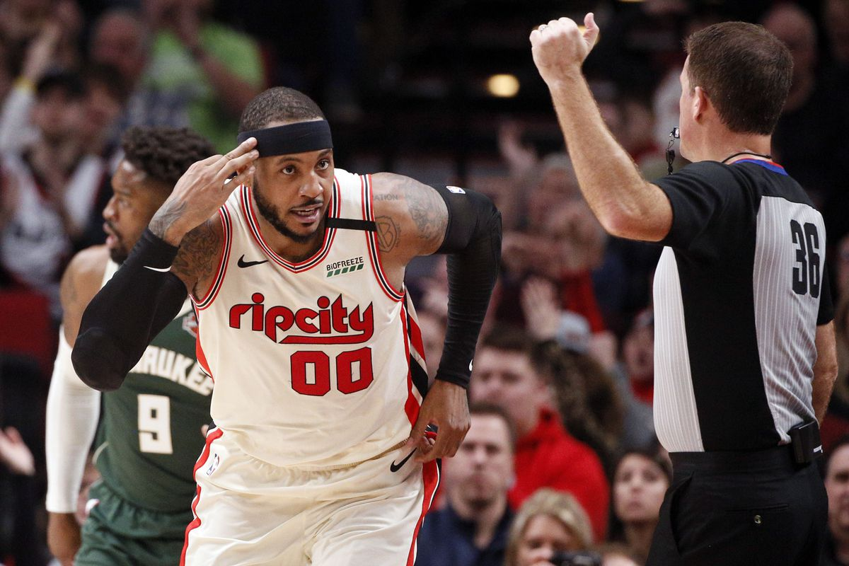 Portland Trail Blazers power forward Carmelo Anthony reacts after a shot against the Milwaukee Bucks during the first half at Moda Center.