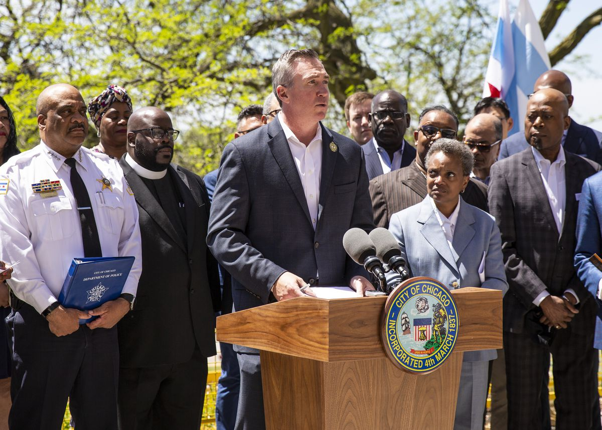Mayor Lori Lightfoot, Chicago Police Superintendent.  Eddie Johnson and other city officials watch Chicago Park District CEO Mike Kelly speak at a press conference in Ellis Park on May 23, 2019. Kelly was fired Friday as Park District superintendent for allegedly mismanaging a lifeguard scandal.     Ashlee Rezin / Sun-Times