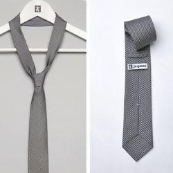 "<span class=""credit""><b>Jegman Ties</b> Fertility Tie, <a href=""http://www.jegman.com/collections/tie-collection-one/products/fertility-tie"">$30</a> (marked down from $75)</span><p>"