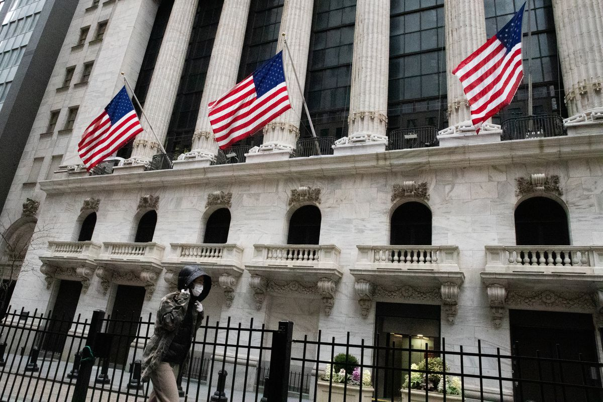 NEW YORK, NY - MARCH 12: A pedestrian walks past the New York Stock Exchange (NYSE) on the floor of the New York Stock Exchange (NYSE) on March 12, 2020 in New York City. The Dow Jones Industrial Average dropped 2,352 points, an almost 10 percent decline and biggest since 1987. (Photo by Jeenah Moon/Getty Images) ORG XMIT: 775495400