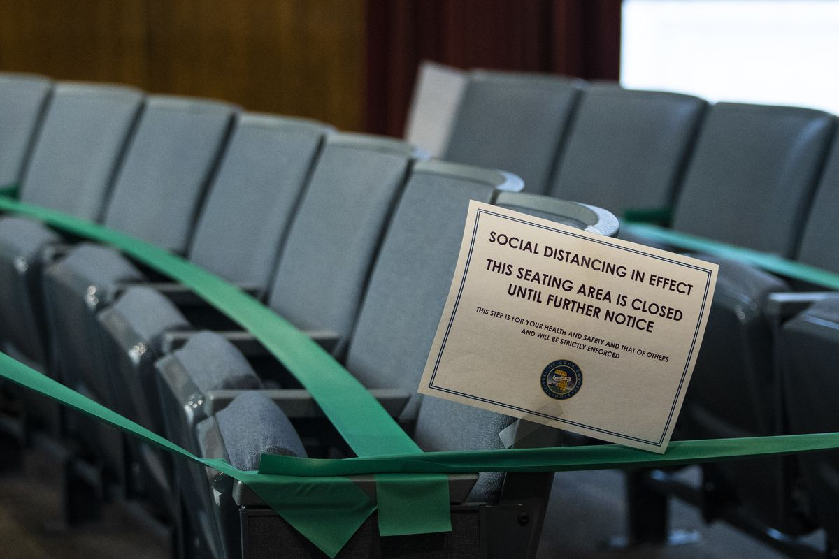 Seats were taped off and marked at the Cook County Board meeting Monday.