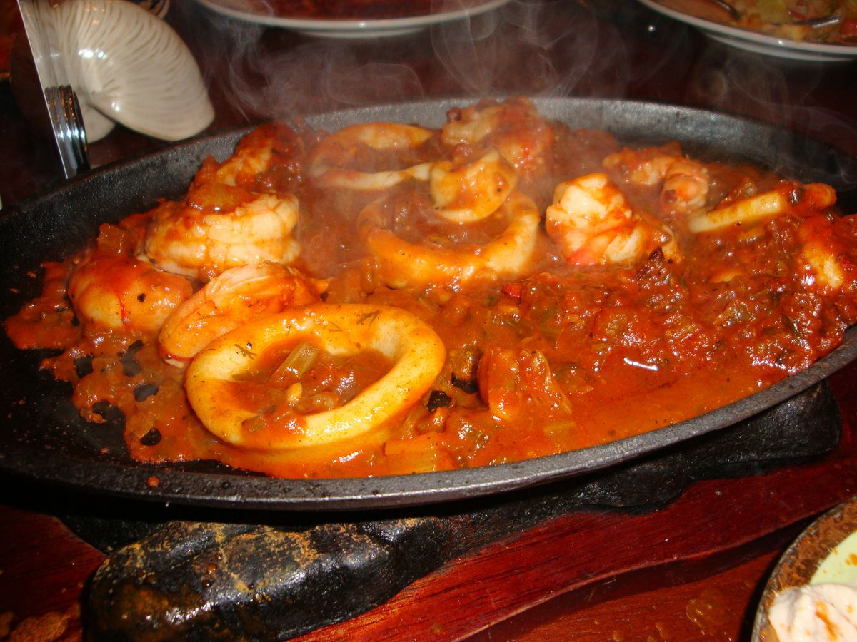 A bubbling red sauced casserole filled with shrimp and big rings of calamari.