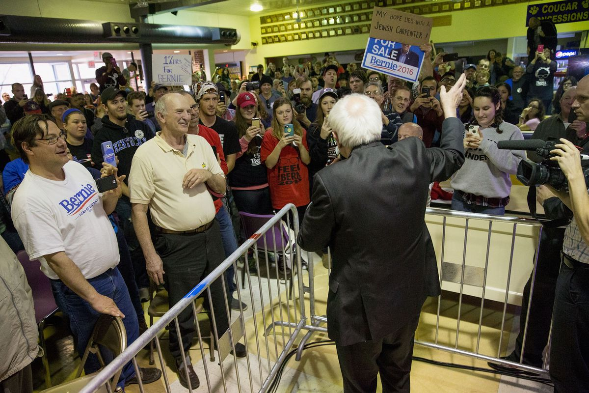 Democratic presidential candidate Bernie Sanders speaks to supporters in an overflow room for a campaign rally on March 13, 2016, in St. Louis, Missouri.