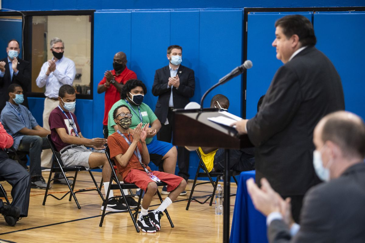 Students and parents at Southside Occupational Academy High School applaud as Gov. J.B. Pritzker discusses two pieces of legislation aimed at helping students with disabilities, during a news conference Wednesday morning at the South Side school.