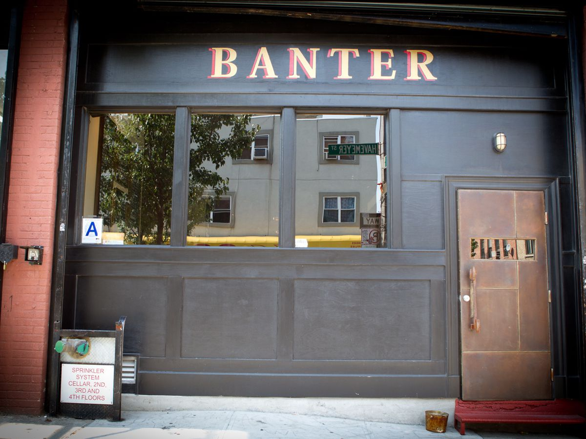 Black exterior of a sports bar with a sign that says Banter