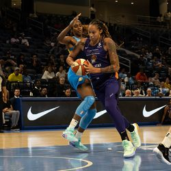Brittney Griner drives past Cheyenne Parker in the paint.