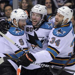 San Jose Sharks defenseman Jason Demers, center, celebrates his goal with teammates Martin Havlat, left, of the Czech Republic and Daniel Winnik during the first period of an NHL hockey game against the Los Angeles Kings, Thursday, April 5, 2012, in Los Angeles.