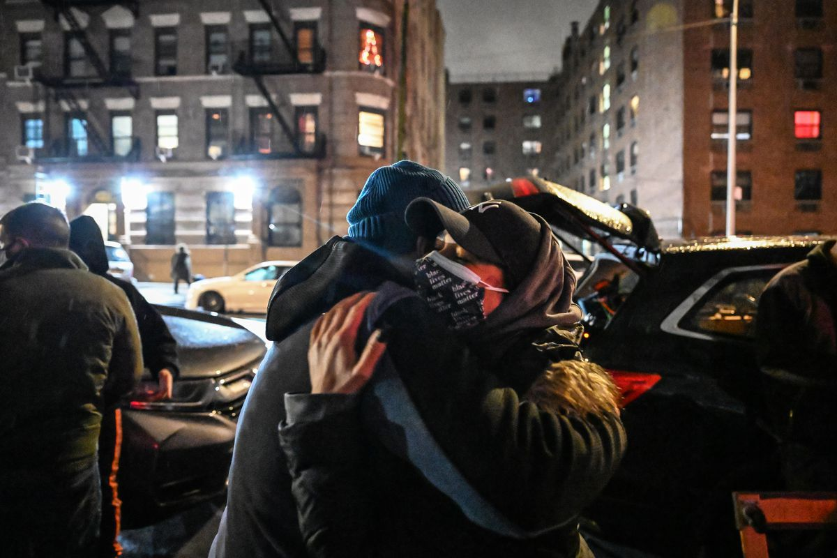 Adela Brito embraces her uncle at a new Bronx community fridge site in Mott Haven, Dec. 4, 2020.