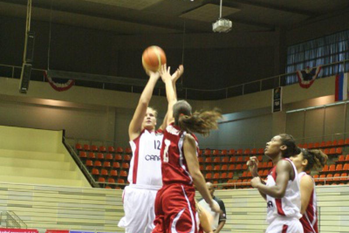 Natalie Achonwa puts up a shot against Tunisia (courtesy of FIBA)