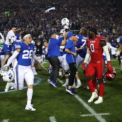 BYU players celebrate and Utah players look for the exit as they fall to the Cougars in an NCAA football game at LaVell Edwards Stadium in Provo on Saturday, Sept. 11, 2021. BYU won 26-17, ending a nine-game losing streak to the Utes.