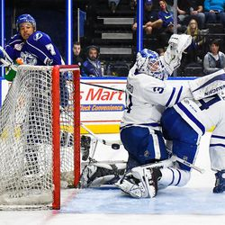 Syracuse Crunch Mathieu Joseph (7) hits the puck past Toronto Marlies defenders Justin Holl (4) and goalie Calvin Pickard (31) but it went through the crease and out in American Hockey League (AHL) Calder Cup Playoff action at the War Memorial Arena in Syracuse, New York on Sunday, May 6, 2018. Toronto won 7-1.