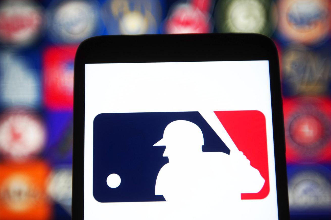 In this photo illustration a Major League Baseball (MLB)...